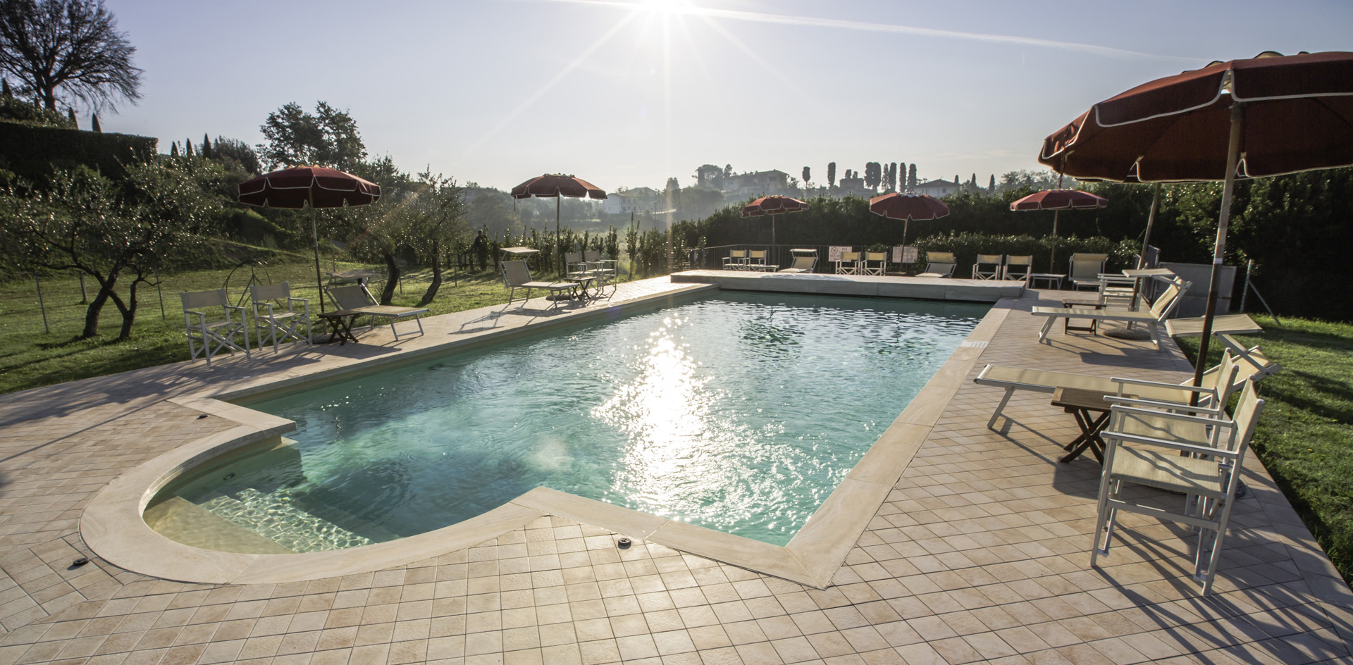 Relax by the pool surrounded by the olive trees and cypresses of Tuscany